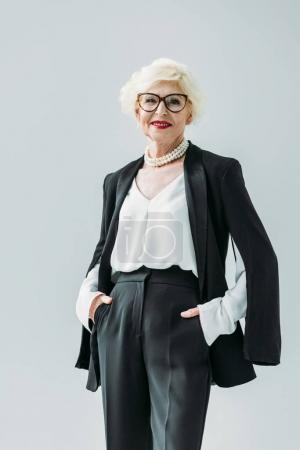 lady in black suit and pearl necklace
