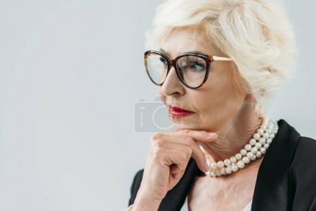 pensive senior lady