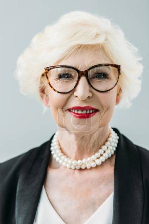 senior lady with pearl necklace