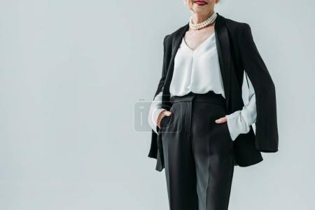Senior lady in black suit