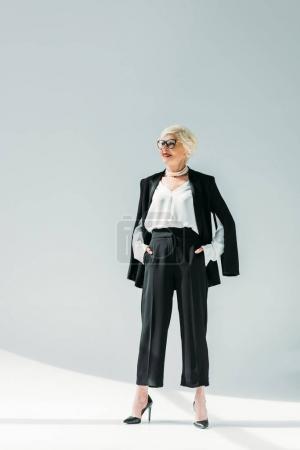 senior lady in black suit