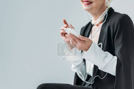 Senior lady with smartphone