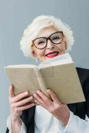 senior lady reading book