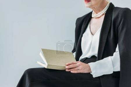 senior lady with book