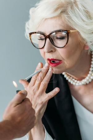 senior lady smoking cigarette