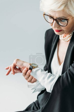 senior woman looking at watch
