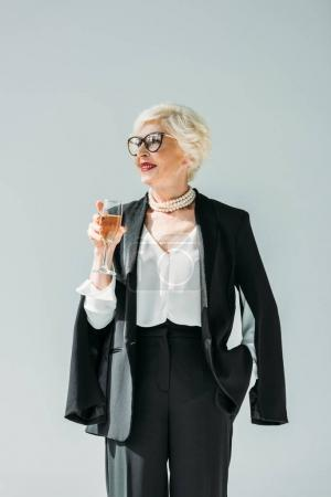 senior woman with champagne