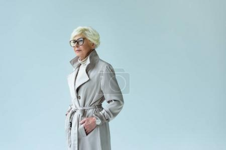 senior lady in autumn trench coat