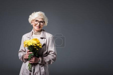 senior woman with yellow flowers