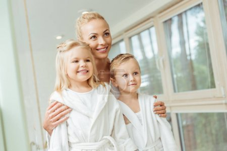 Mother and children in bathrobes
