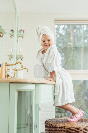 kid in bathrobe and towel on head