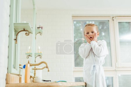 little boy in bathroom