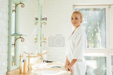 beautiful woman in bathrobe