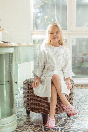 adorable child in bathrobe