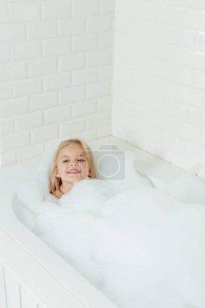 adorable child in bathtub