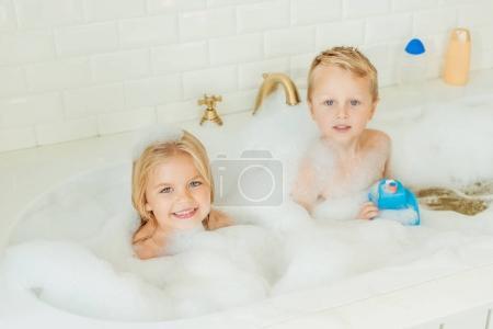 kids playing in bathtub with foam