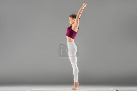 woman standing in yoga pose