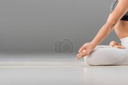 Photo for Cropped shot of young woman performing lotus pose on grey - Royalty Free Image