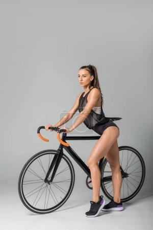 Gorgeous young woman with bicycle