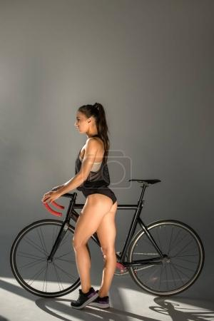 seductive young woman with bicycle