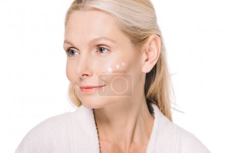 mature woman with cosmetic cream on face