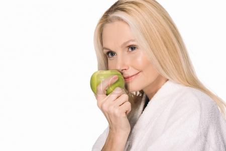 Photo for Happy mature woman with green apple isolated on white - Royalty Free Image