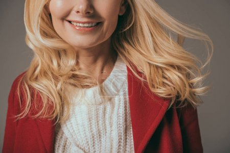 smiling woman in red coat