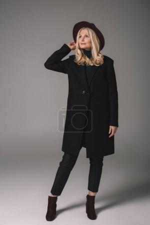 mature woman in coat and hat