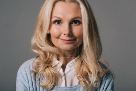 Photo for Close-up portrait of happy mature woman isolated on grey - Royalty Free Image