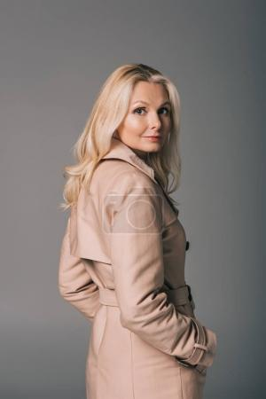 mature woman in trench coat