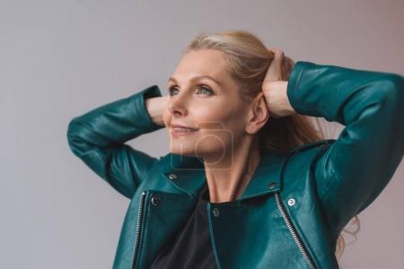 mature woman touching hair