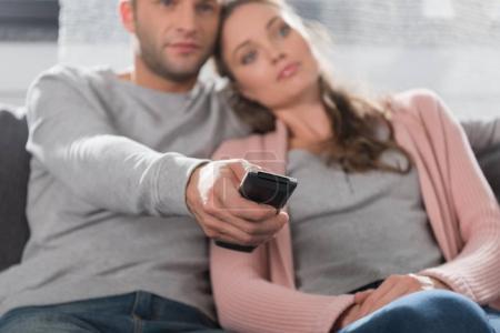 Boyfriend holding remote controller