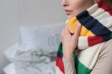 Sick woman with scarf over neck
