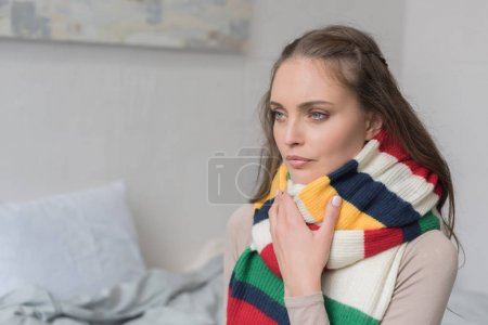 Sick woman in scarf over neck