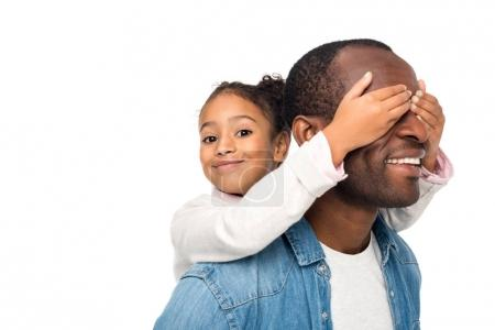 Daughter closing eyes to father
