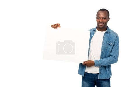 Photo for Handsome african american man holding blank banner and smiling at camera isolated on white - Royalty Free Image