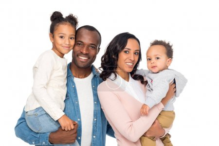 Photo for Happy african american parents holding cute little kids and smiling at camera isolated on white - Royalty Free Image