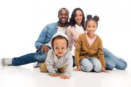 Photo for Happy african american family with two kids sitting together and smiling at camera isolated on white - Royalty Free Image