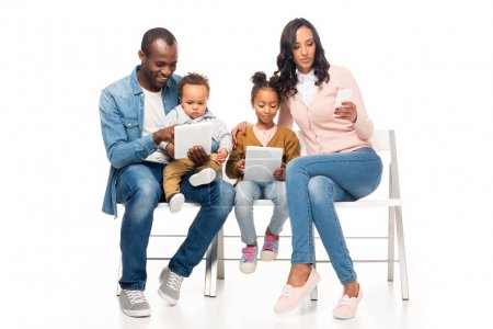 african american family using devices
