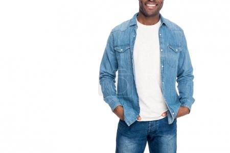Photo for Cropped shot of smiling african american man standing with hands in pockets isolated on white - Royalty Free Image