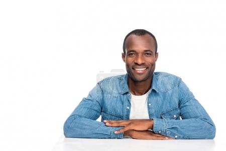 Photo for Portrait of handsome african american man smiling at camera isolated on white - Royalty Free Image