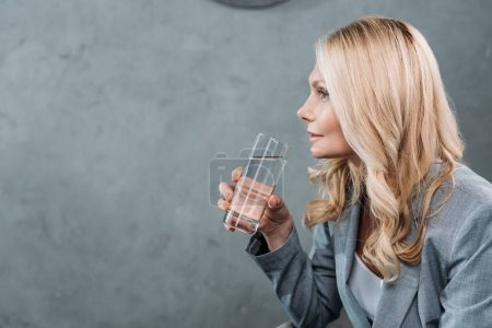 businesswoman with glass of water