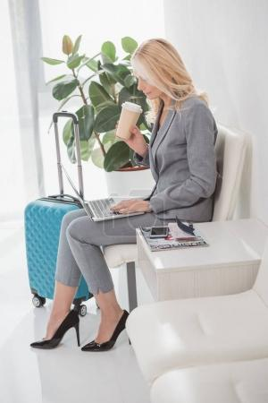 businesswoman working with laptop and drinking coffee