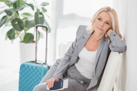 tired businesswoman waiting for trip