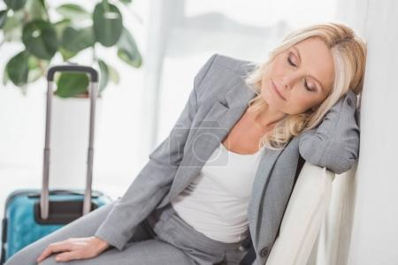 exhausted businesswoman waiting for trip