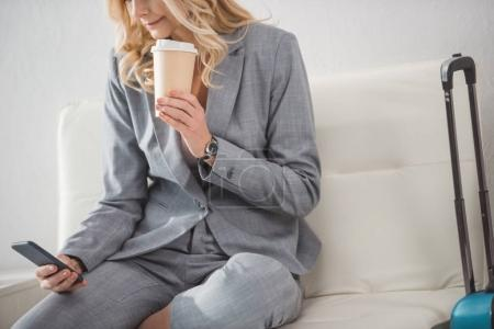businesswoman with coffee and smartphone