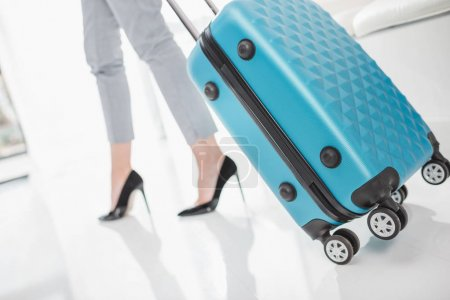 woman in high heels with suitcase