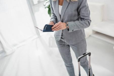 businesswoman with passport and flight ticket