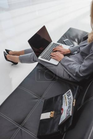 Photo for High angle view of businesswoman working with laptop - Royalty Free Image