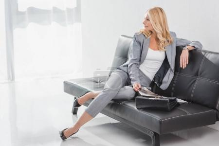 businesswoman relaxing on couch